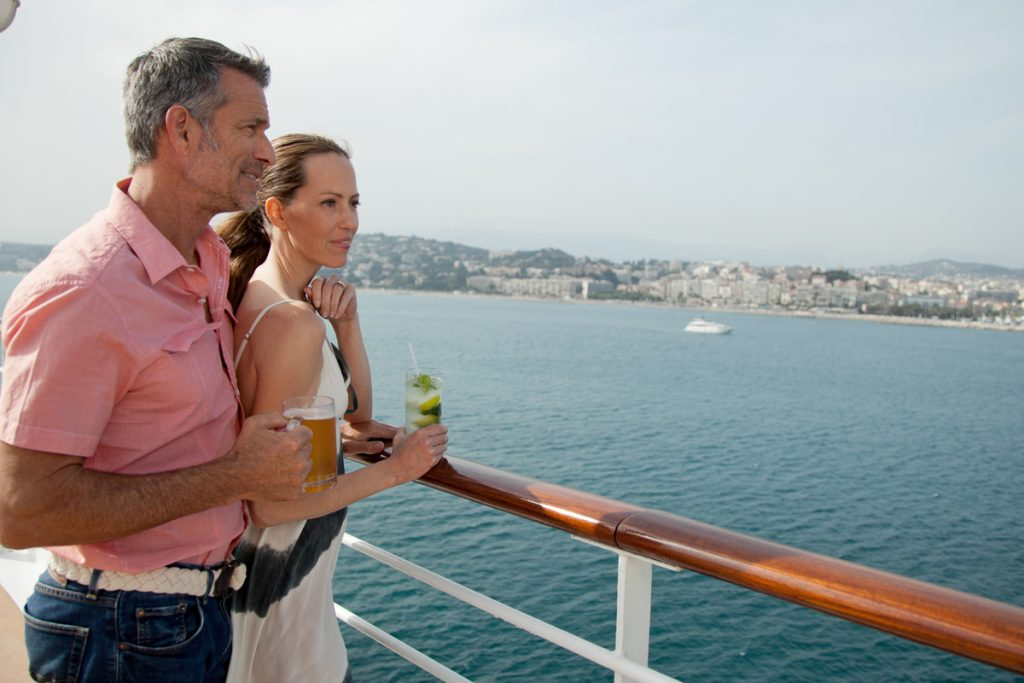 Couple on cruise deck with drinks