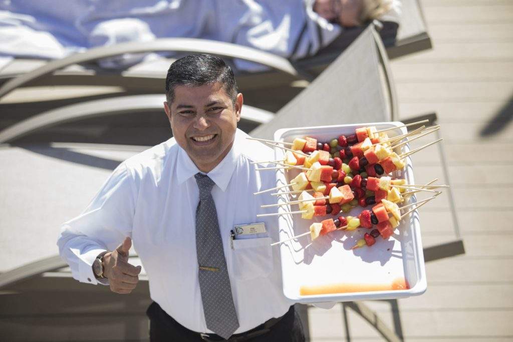 Waiter with fruit on cruise