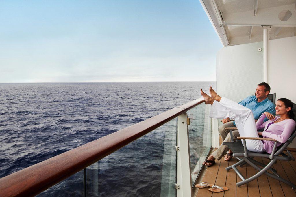 Couple on balcony cruise
